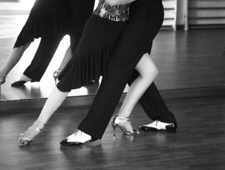 137676469-ballroom-dance-salsa-dancer-instructors-man-and-woman-couple-dancing-in-shcool-rehearsal-room