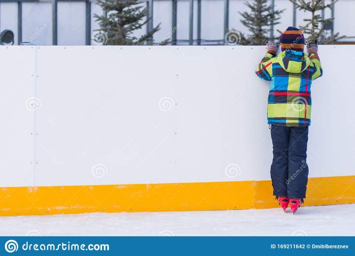 little-boy-red-skate-winter-sunny-day-little-boy-red-skates-stands-ice-resting-laps-holding-169211642